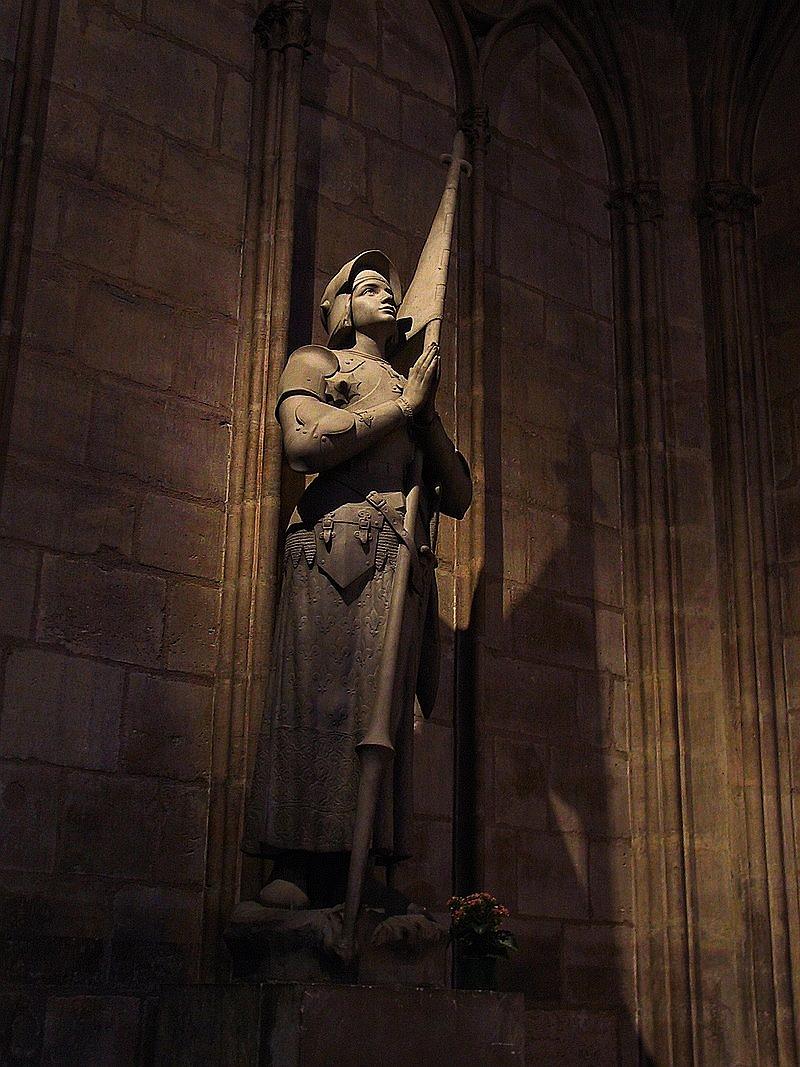 Parte Guelfa Giovanna dArco prega in armatura Cattedrale di Notre Dame de Paris